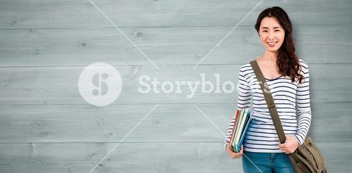 Composite image of cheerful woman with shoulder bag and files