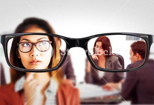 Composite image of thoughtful businesswoman with eyeglasses