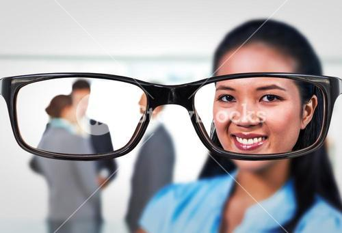 Composite image of smiling businesswoman posing for camera