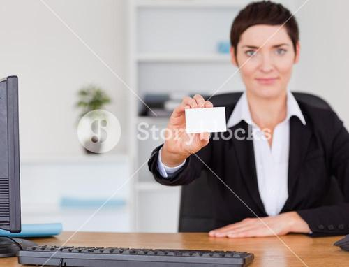 Businesswoman showing a blank business card