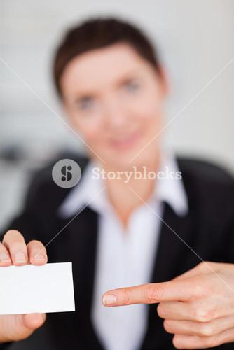 Portrait of a woman showing a blank business card