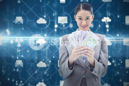 Composite image of portrait of a businesswoman holding bank notes