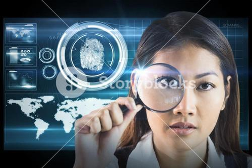 Composite image of businesswoman looking through magnifying glass