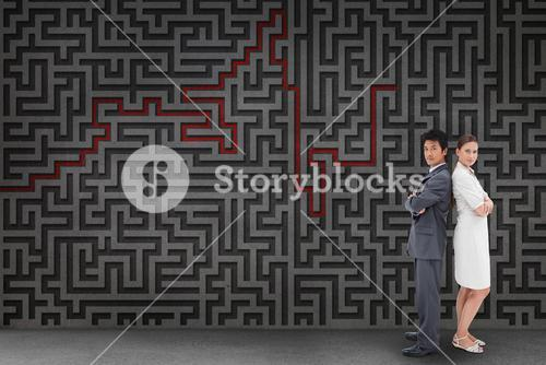 Composite image of portrait of business people standing back-to-back