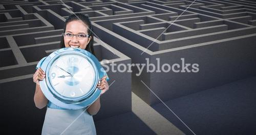 Composite image of delighted businesswoman holding a clock