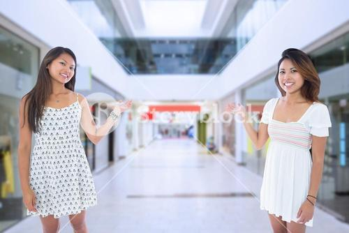 Composite image of two pretty asian women presenting