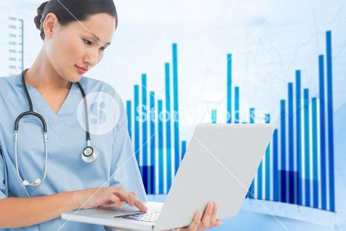 Composite image of concentrated surgeon using a laptop in hospital