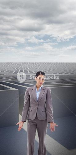 Composite image of portrait of a confused young businesswoman