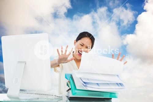 Composite image of businesswoman shouting with stack of folders at desk
