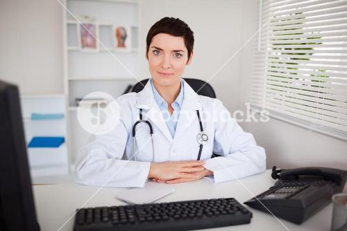Serious doctor looking at the camera
