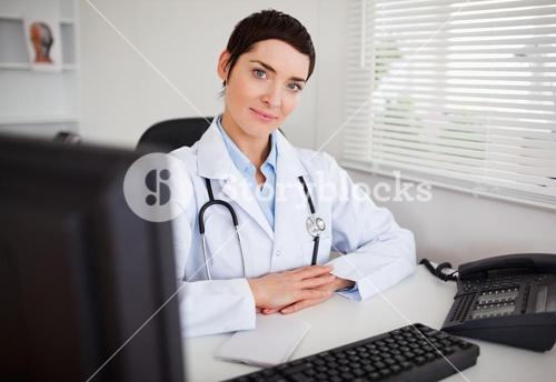 Serious female doctor looking at the camera