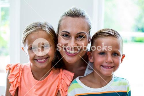 Portrait of happy mother with children at home