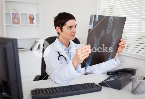 Young doctor looking at Xray
