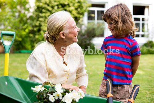 Smiling granny with grandson at yard