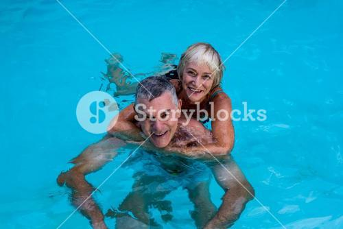 Senior couple enjoying in swimming pool