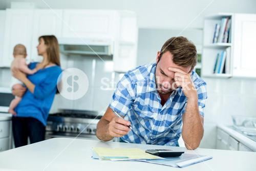 Tensed father calculating home finance