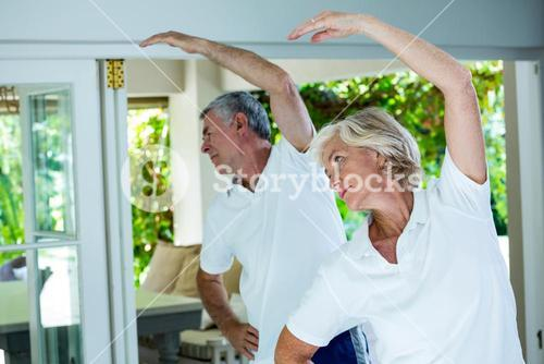 Senior couple doing aerobics