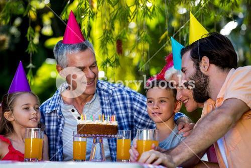 Family celebrating birthday at yard