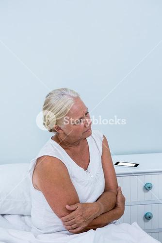 Senior woman having stomach pain