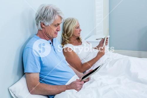 Retired couple with tablets