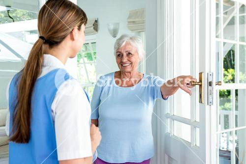 Happy aged woman standing nurse