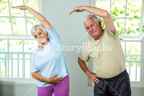 Portrait of senior man and woman exercising