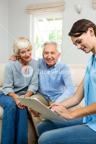 Consultant with senior couple at home