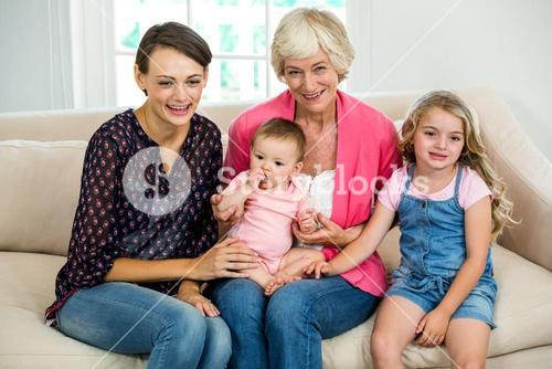 Smiling multi generation family with baby