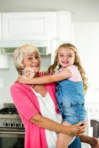 Happy granny carrying girl