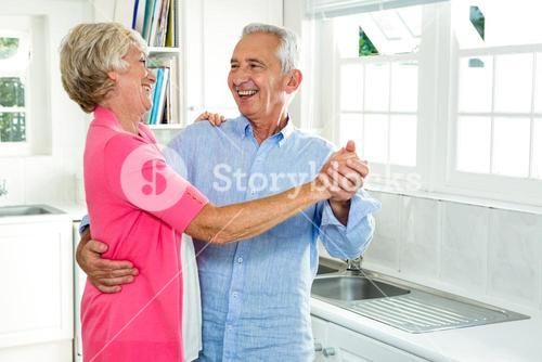 Cheerful senior couple dancing