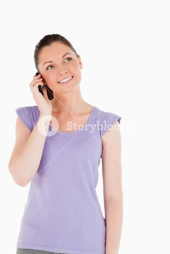 Good looking woman on the phone while standing