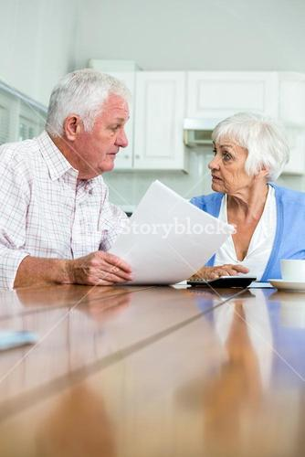 Senior couple discussing with documents