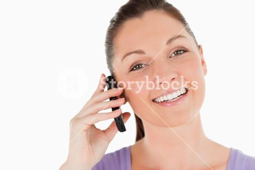 Portrait of an attractive woman on the phone while standing
