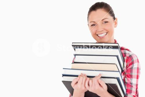 Gorgeous female posing with books while standing