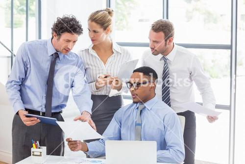 Business colleagues discussing a report