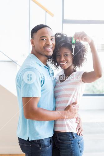Young couple showing their house key