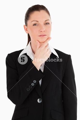 Lovely female in suit posing while standing
