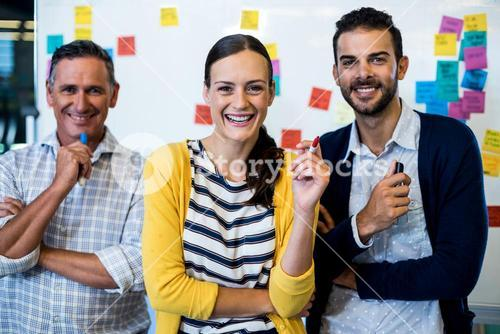 Business colleagues smiling at camera
