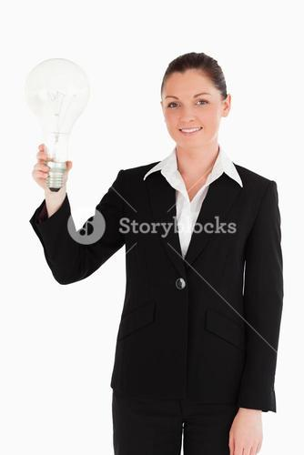 Lovely woman in suit holding a light bulb while standing