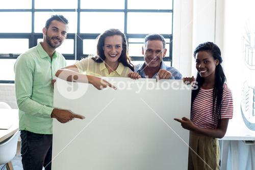 Colleagues holding blank board