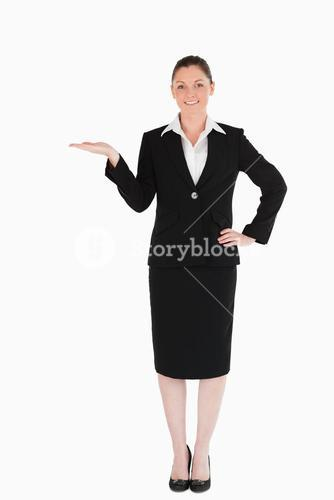 Charming woman in suit showing a copy space