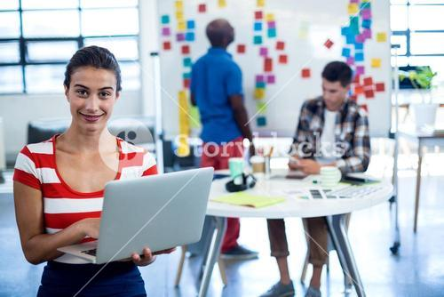 Young woman holding laptop