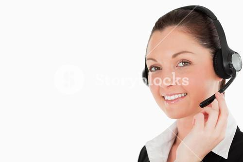 Portrait of a gorgeous woman in suit using headphones and posing