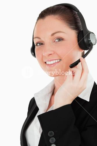 Portrait of a lovely woman in suit using headphones and posing