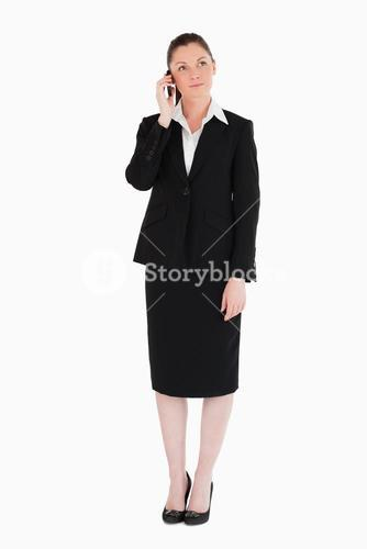 Charming woman in suit on the phone