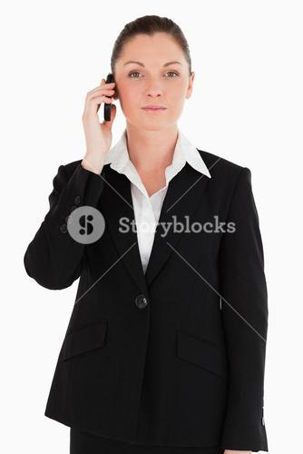 Pretty woman in suit on the phone