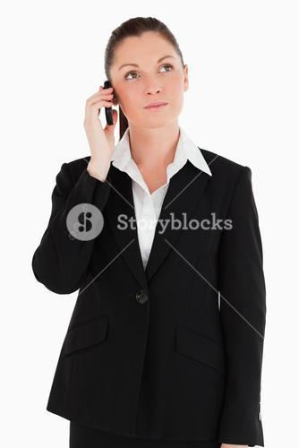 Good looking woman in suit on the phone