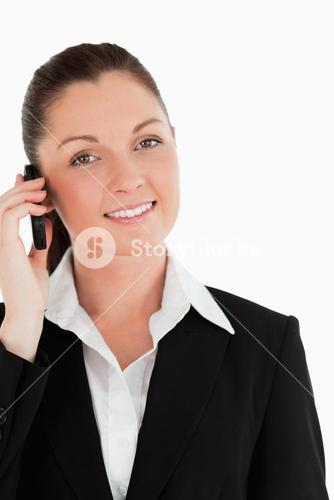 Portrait of a beautiful woman in suit on the phone