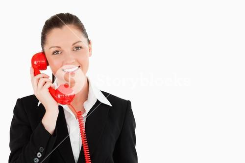 Good looking female in suit on the phone