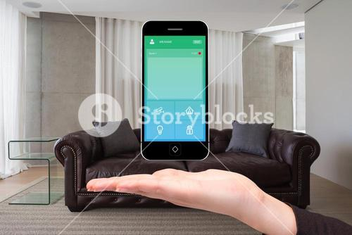Hand showing home automation on phone